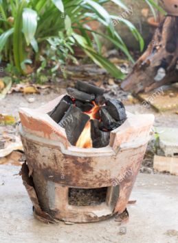 Traditional clay stove using charcoal flame